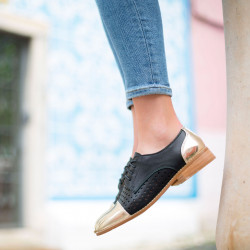 Black perforated brogues with contrasting toe